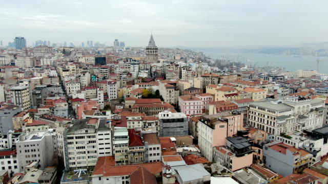 vidéos et rushes de aerial view over galata tower and i̇stiklal avenue or istiklal street, bustling city thoroughfare known for its boutiques, galleries, theatres & numerous eateries-  istanbul, turkey - istanbul