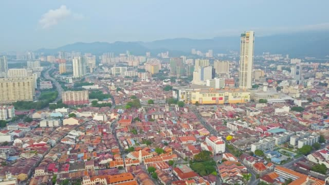 aerial view over george town and komtar tower, heritage penang located on the northwest coast of peninsular malaysia - penang stock videos and b-roll footage
