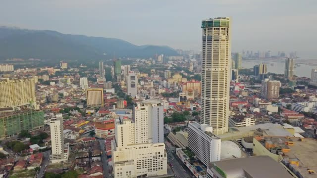 aerial view over george town and komtar tower penang's tallest skyscraper, heritage penang located on the northwest coast of peninsular malaysia - penang stock videos and b-roll footage
