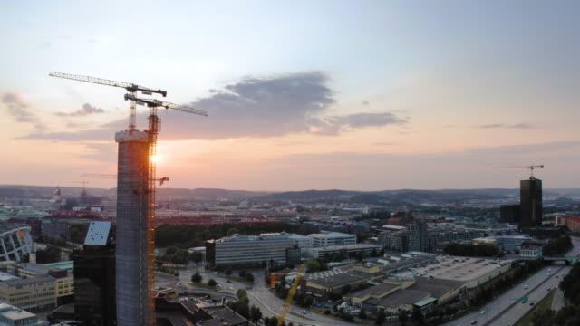 stockvideo's en b-roll-footage met luchtmening over de stad van göteborg bij zonsondergang - sweden