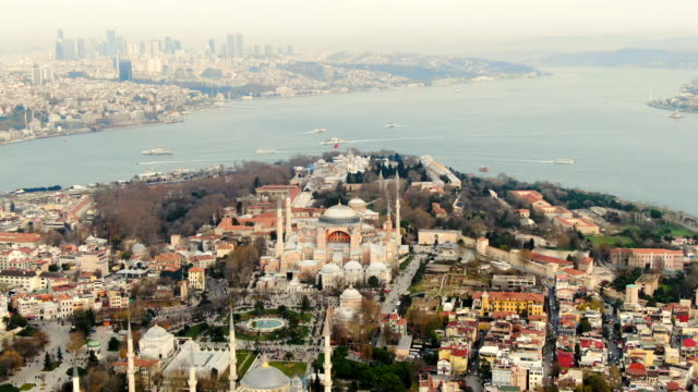 vidéos et rushes de aerial view over hagia sophia museum with glittering mosaics of biblical scenes in vast, domed former byzantine church and mosque -  istanbul, turkey - byzantin