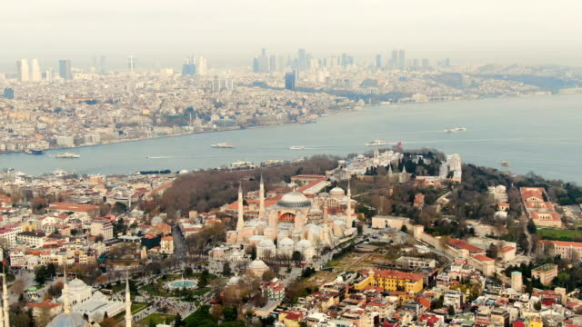 aerial view over hagia sophia museum with glittering mosaics of biblical scenes in vast, domed former byzantine church and mosque -  istanbul, turkey - istanbul stock videos & royalty-free footage