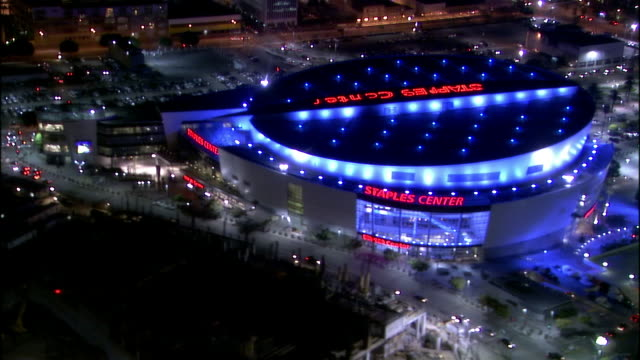 Aerial view over illuminated Staples Center at night / Los Angeles, California