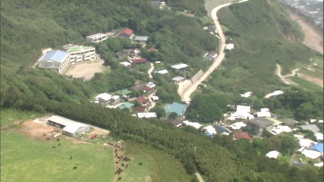 aerial view over kuchinoshima island in tokara islands - schoolhouse stock videos & royalty-free footage