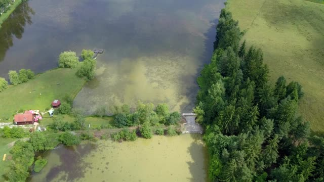 vidéos et rushes de aerial view over lakes of vulcan in brasov county romania - transylvanie