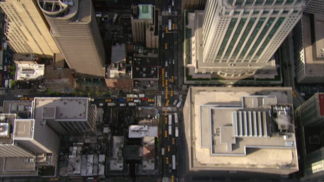 aerial view over lexington avenue towards downtown manhattan / over chrysler building / new york, new york - chrysler building stock videos & royalty-free footage