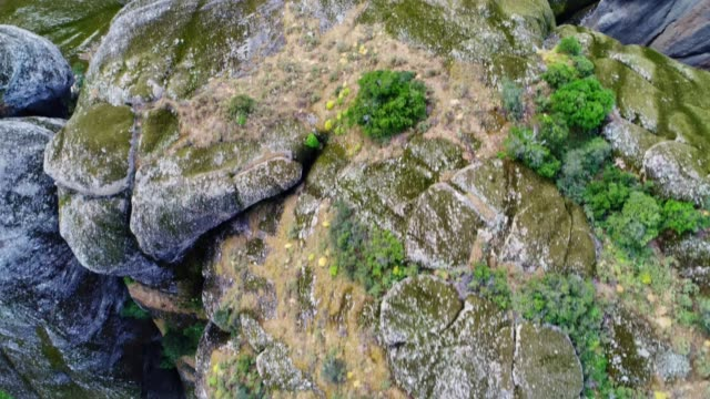 Aerial view over Meteora cliffs, drone flight in springtime over the Meteora monasteries site, famous places in Greece, travel destinations, UNESCO world heritage site