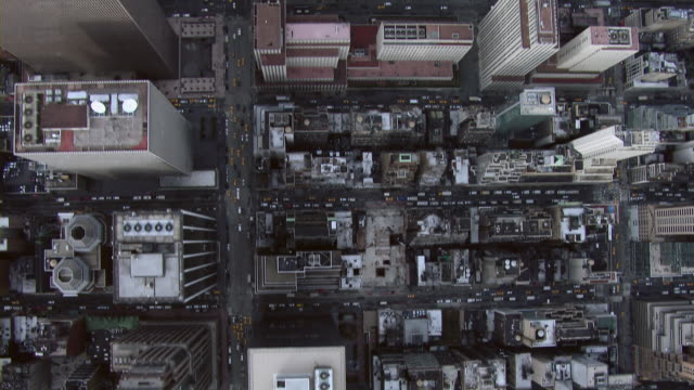 aerial view over midtown manhattan skyscrapers, looking straight down. - rockefeller center video stock e b–roll