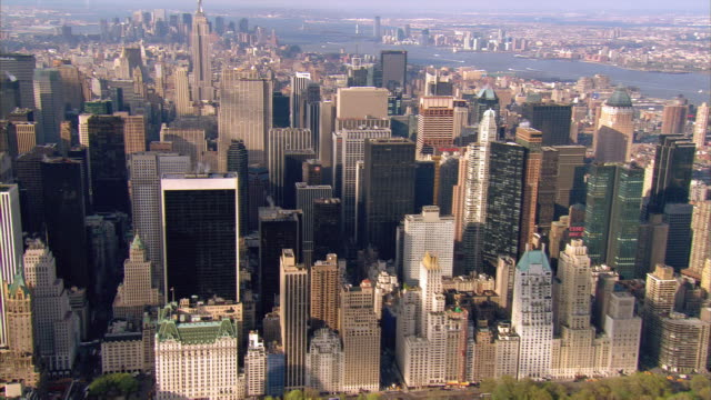 aerial view over midtown manhattan towards empire state building / new york city, new york - cinematography stock videos & royalty-free footage