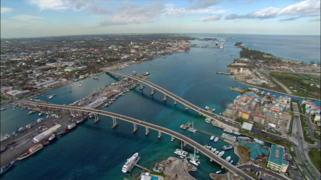 aerial view over paradise island, paradise island bridge, and cruise ships in nassau harbour/ bahamas - bahamas stock videos & royalty-free footage
