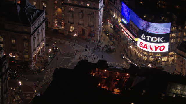 aerial view over people in piccadilly circus / zoom out to view of the west end / london, england - piccadilly circus stock videos and b-roll footage