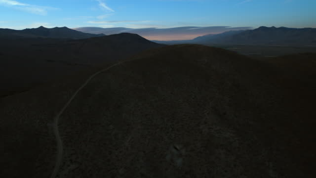 aerial view over poverty hills at twilight, owens valley, california. - basin and range province stock videos and b-roll footage