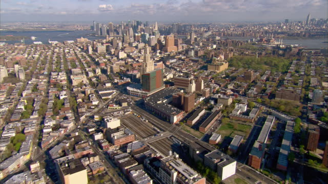 aerial view over prospect heights, brooklyn and atlantic train yards towards downtown brooklyn / new york city, new york - brooklyn new york stock videos & royalty-free footage