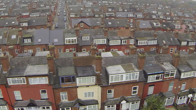 aerial view over roads and houses in sheffield - sheffield stock videos & royalty-free footage
