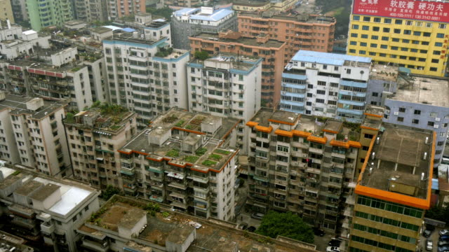 aerial view over run-down residential district in guangzhou, china. wide shot - spoonfilm stock-videos und b-roll-filmmaterial