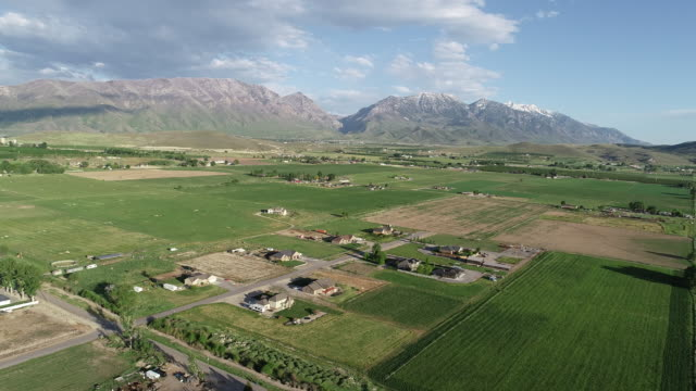 aerial view over rural utah farms and farmland - utah stock videos & royalty-free footage