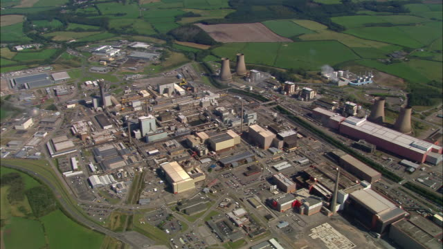 aerial view over sellafield nuclear site / clouds hanging overhead / cumbria, england - sellafield nuclear power station stock videos & royalty-free footage