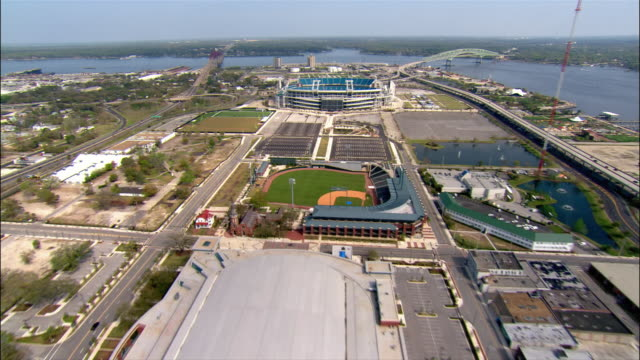 aerial view over sports complex and i-95, including alltel stadium, baseball grounds of jacksonville, and veterans memorial stadium/ jacksonville, florida - jacksonville florida stock videos and b-roll footage
