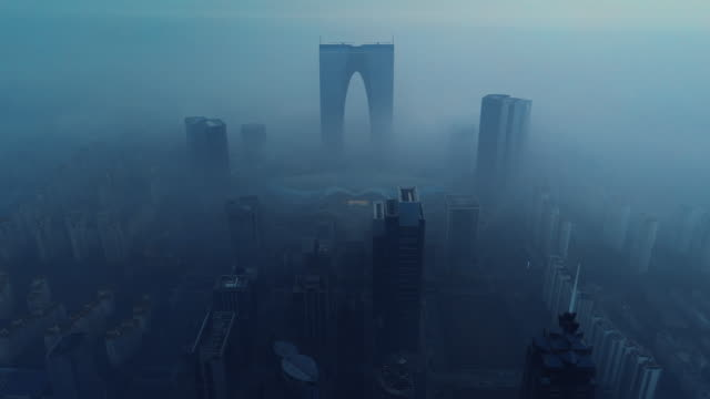 aerial view over suzhou with fog between skyscrapers at sunrise - jiangsu province stock videos & royalty-free footage