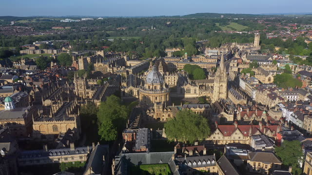aerial view over the city centre and university buildings, oxford, oxfordshire, england, united kingdom - film composite stock videos & royalty-free footage