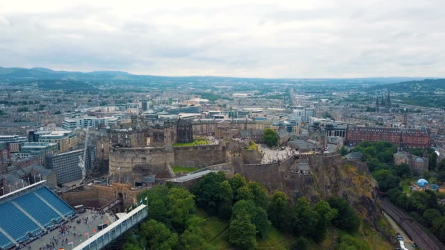 aerial view over the city centre of edinburgh, scotland. edinburgh castle - edinburgh castle stock videos & royalty-free footage
