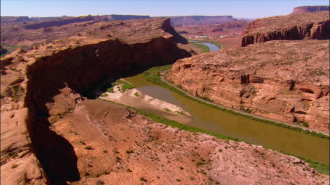 aerial view over the colorado river snaking through the slick rock canyons near deadhorse point state park / utah - moab utah stock videos & royalty-free footage