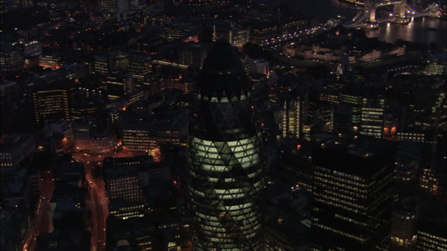 aerial view over the financial district and 30 st. mary axe at night / london, england - cityscape stock videos & royalty-free footage