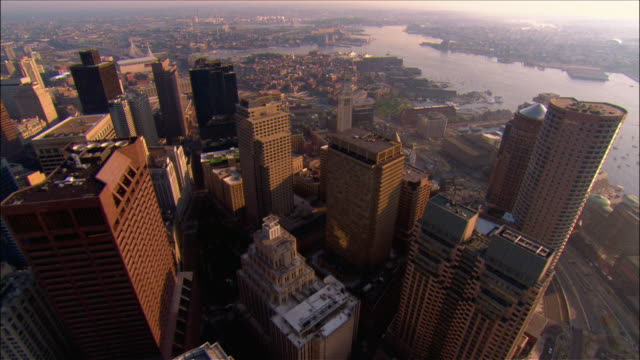 aerial view over the financial district towards the bunker hill bridge / boston, massachusetts - boston stock videos and b-roll footage