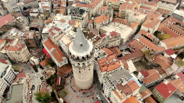 vidéos et rushes de aerial view over the galata tower - restored 5th-century tower and former prison overlooking the bosphorus with top-floor restaurant-  istanbul, turkey - istanbul