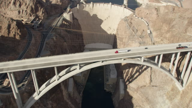 aerial view over the hoover dam and mike o'callaghan–pat tillman memorial bridge - hydroelectric power stock videos and b-roll footage