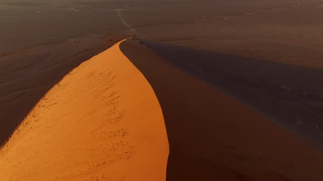 aerial view over the namib desert, sossusvlei sand dunes, namibia, africa - sand dune stock videos & royalty-free footage