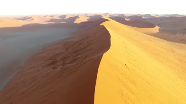 stockvideo's en b-roll-footage met aerial view over the namib desert, sossusvlei sand dunes, namibia, africa - namibië