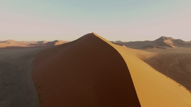 aerial view over the namib desert, sossusvlei sand dunes, namibia, africa - namibian desert stock videos and b-roll footage