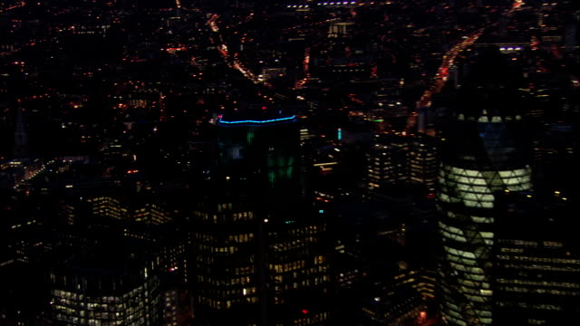 aerial view over the old natwest tower (tower 42) at night / zoom out to view of 30 st. mary axe / london, england - 2005 stock videos & royalty-free footage