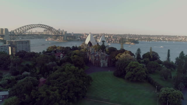 Aerial view over the Royal Botanical Garden to reveal the Sydney Opera House. Sydney Australia
