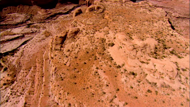 aerial view over the slick rock canyons near moab towards the colorado river / utah - mesa stock videos and b-roll footage