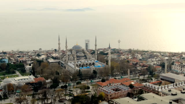 aerial view over the sultan ahmet mosque, also known as the blue mosque, built in 1616 & containing its founder's tomb-  istanbul, turkey - blue mosque stock videos & royalty-free footage