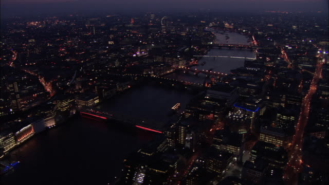 aerial view over the thames at night / london, england - 2005 stock videos & royalty-free footage