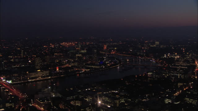 Aerial view over the Thames at night / London, England