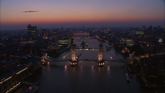 Aerial view over Tower Bridge and the River Thames at dawn or dusk / London, England