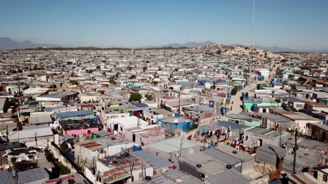 aerial view over township in south africa - poverty stock videos & royalty-free footage