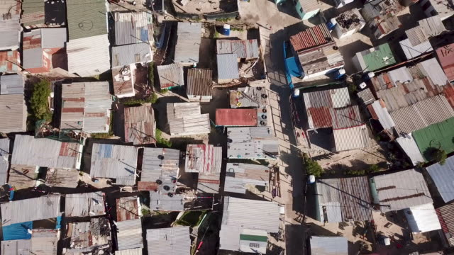 aerial view over township in south africa - povertà video stock e b–roll