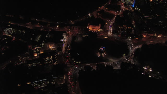 aerial view over traffic circling hyde park corner at night / london, england - 2005 stock videos & royalty-free footage