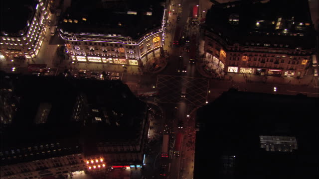 Aerial view over traffic in Oxford Circus at night / London, England