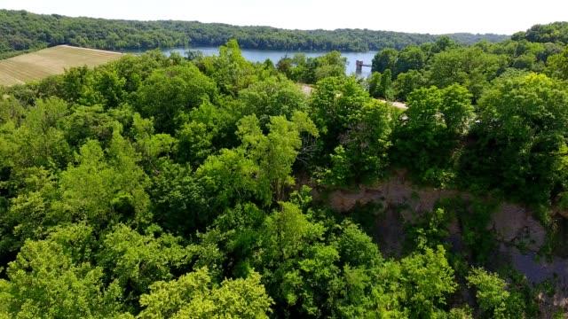 aerial view over treetops towards wyandotte county lake in kansas city kansas - kansas stock videos & royalty-free footage