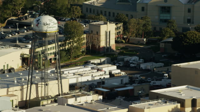 aerial view over universal film studios hollywood california - burbank stock-videos und b-roll-filmmaterial