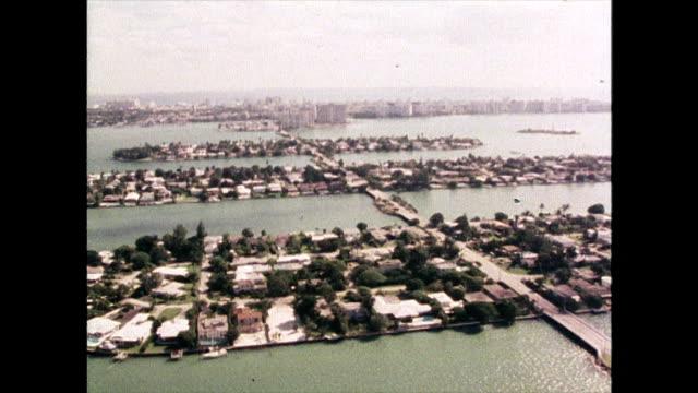 stockvideo's en b-roll-footage met aerial view over venetian islands in miami; 1980 - venetian causeway bridge