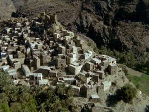 wa aerial view over village of bilad seet in northern mountains, oman - animal markings stock videos & royalty-free footage