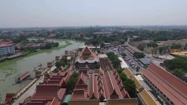 aerial view over wat phanan choeng is a buddhist temple in the city of ayutthaya, thailand, on the east bank of the chao phraya river at the... - アユタヤ県点の映像素材/bロール