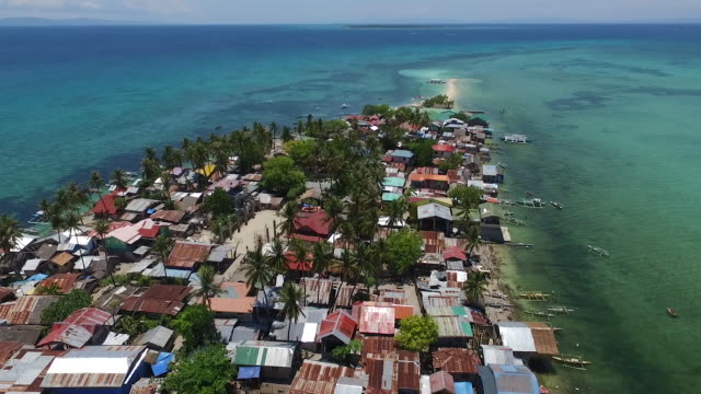 aerial view - overpopulated tropical island - population explosion stock videos and b-roll footage